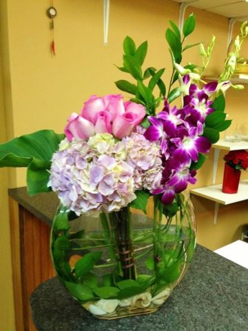 half moon orchids arrangement